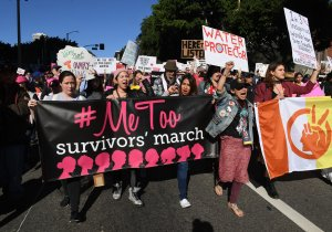 Protesters march during the Women's Rally on the one-year anniversary of the first Women's March, when millions marched around the world to protest U.S. President Donald Trump's inauguration, in Los Angeles on Jan. 20, 2018. (Credit: Mark Ralston/AFP/Getty Images)