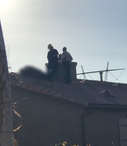 A blurred photo shows a skydiver who landed on the roof of a Perris home on Jan. 22, 2018. (Credit: Ali and Iryna Muhassen)