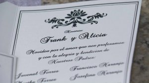 An invite for the wedding of Frank Naranjo and Alicia Torres, which had to be canceled after a fire at the church it was to be held in, is seen on Jan. 25, 2018. (Credit: KTLA)