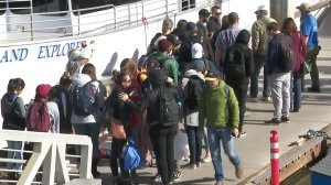People line up on the deck alongside a ferry from Island Packers in Ventura to travel by boat to Santa Barbara, as freeways remain closed due to mudslides, on Jan. 10, 2018. (Credit: KTLA)