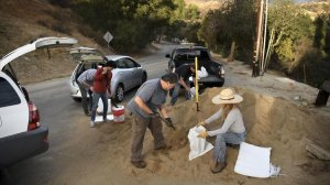 People living in Kagel Canyon in the Sunland area, where recent wildfires have left charred land vulnerable to mudslides, fill up sand bags at a fire station on Jan. 7, 2018, to prepare for a coming rainstorm. (Credit: Wally Skalij / Los Angeles Times)