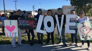The youth ministry from the St. Angela Merici Catholic Church in Brea attends the OneLife LA march in Chinatown on Jan. 20, 2018. (Credit: Deborah Netburn / Los Angeles Times)