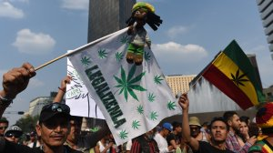 Activists march along Reforma Avenue in Mexico City on May 6, 2017 demanding the depenalization of marijuana. (Credit: YURI CORTEZ/AFP/Getty Images)