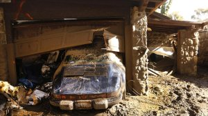 A Porsche pushed from the garage at a home on East Valley Road shows how far water rose above its banks. (Credit: Al Seib / Los Angeles Times)