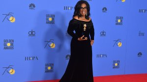 Actress and TV talk show host Oprah Winfrey poses with the Cecil B. DeMille Award during the 75th Golden Globe Awards on Jan. 7, 2018. (Credit: Frederic J. Brown/AFP/Getty Images)