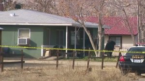 Authorities investigate a triple homicide in a Palmdale home on Jan. 14, 2018. (Credit: KTLA)