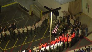 Dozens of law enforcement personnel honor Deputy Falce at a procession on Jan. 2, 2018. (Credit: KTLA)