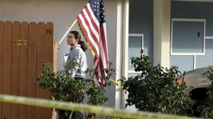 An investigator searches for evidence at the home of a retired L.A. County sheriff's deputy who was shot while answering his door on Jan. 4, 2018. (Credit: Wally Skalij / Los Angeles Times)