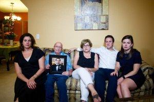 The Jabara family holds a photo of deceased relative Khalid. From left are Victoria, Mounha, Haifa, Rami and Jenna. (Credit: Mallory Simon / CNN)