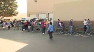 Customers line up to get into Sam's Club in Sylmar as the store offers discounts ahead of its closing. (Credit: KTLA)