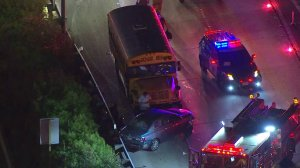 A school bus involved in a collision with an ambulance and a sedan is seen on the 405 Freeway on Jan. 31, 2018. (Credit: KTLA)
