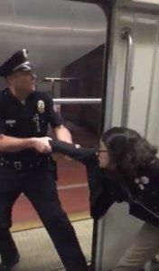 Bethany Renee Nava is seen being pulled off a Metro train on Jan. 22, 2018. (Credit: Brock Bryan)