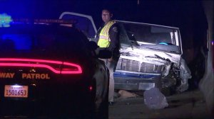 Authorities investigate the scene where a pickup driving the wrong way crashed into a motorcyclist on the 405 Freeway in Torrance on Feb. 4, 2018. (Credit: KTLA)
