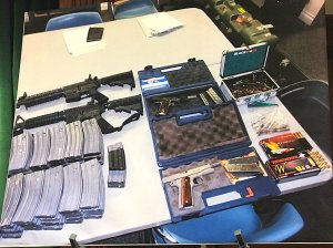 A weapons cache confiscated from the home of a 17-year-old who allegedly threatened to shoot up his Whittier-area high school is shown at a sheriff's news conference on Feb. 21, 2018. (Credit: Steve Kuzj / KTLA)