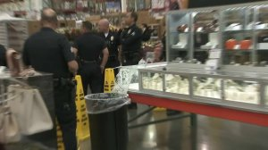 Officers investigate a scene after three men reportedly robbed a Costco in Pacoima on Feb. 12, 2018. (Credit: KTLA)