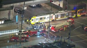 Los Angeles police and fire officials respond to the scene of a light rail train crash in South Los Angeles on Feb. 6, 2018. (Credit: KTLA)