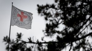 A flag floats at the top of the International Committee of the Red Cross headquarters in Geneva, Switzerland on June 4, 2014. (Credit: FABRICE COFFRINI/AFP/Getty Images)