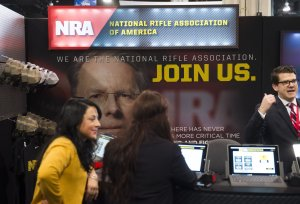Attendees visit the National Rifle Association (NRA) booth during the annual Conservative Political Action Conference (CPAC) 2016 at National Harbor in Oxon Hill, Maryland, outside Washington, March 3, 2016. (SAUL LOEB/AFP/Getty Images)