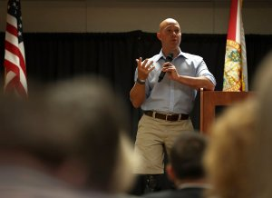 Rep. Brian Mast, R-Fl, speaks during a town hall meeting at the Havert L. Fenn Center on Feb. 24, 2017 in Fort Pierce, Florida. (Credit: Joe Raedle/Getty Images)