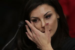 Jamie Dantzscher, former gymnast and 2000 Olympic bronze medalist, wipes away tears while testifying before the Senate Judiciary Committee about her sexual abuse at the hands of doctor Larry Nassar during a hearing in the Dirksen Senate Office Building on Capitol Hill, March 28, 2017. (Credit: Chip Somodevilla / Getty Images)