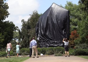 A statue of Confederate Gen. Robert E. Lee is covered with a black tarp as it stands in the center of Emancipation Park, formerly Lee Park, in Charlottesville, Virginia, on Aug. 23, 2017, the same week the Charlottesville city council voted unanimously to cover Confederate statues in black tarp. (Credit: Mark Wilson / Getty Images)