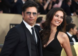 Actor John Stamos, left, and Caitlin McHugh attend the Screen ActorsGuild Awards at The Shrine Auditorium on Jan. 21, 2018. (Credit: Frazer Harrison / Getty Images)
