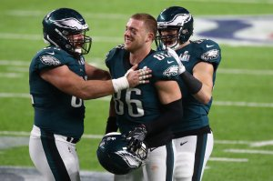 Jason Kelce #62, Brent Celek #87 and Zach Ertz #86 of the Philadelphia Eagles celebrate Ertz's 11 yard touchdown against the New England Patriots during the fourth quarter in Super Bowl LII at U.S. Bank Stadium on February 4, 2018 in Minneapolis, Minnesota. (Credit: Gregory Shamus/Getty Images)