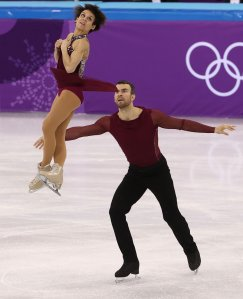 Meagan Duhamel of Canada flies up into the air as she and her skating partner, Eric Radford, compete in the Figure Skating Team Event Pairs Free Skating during the Figure Skating on day two of the PyeongChang 2018 Winter Olympic Games at Gangneung Ice Arena on Feb. 11, 2018, in Gangneung, South Korea. (Credit: Robert Cianflone/Getty Images)