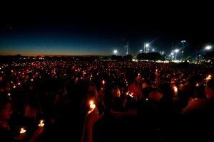 Thousands of mourners attend a candlelight vigil for victims of Marjory Stoneman Douglas High School shooting in Parkland, Florida on Feb. 15, 2018. (Credit: RHONA WISE/AFP/Getty Images)