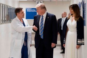 President Donald Trump shakes hands with doctor Igor Nichiporenko beside First lady Melania Trump while visiting first responders at Broward Health North hospital in Pompano Beach, Florida, on Feb. 16, 2018. (Credit: Jim Watson / AFP / Getty Images)