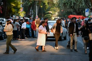 People flood the streets after a powerful earthquake jolted Mexico City on Feb. 16, 2018. (Credit: Alfredo Estrella / AFP / Getty Images)