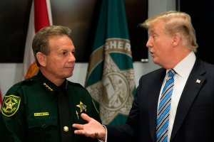 President Donald Trump speaks with Broward County Sheriff Scott Israel while visiting first responders at Broward County Sheriff's Office on Feb. 16, 2018, three days after a mass shooting that claimed 17 lives at a nearby high school. (Credit: Jim Watson / AFP / Getty Images)