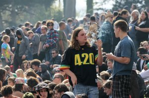 "A man user smokes marijuana during a 420 Day celebration on ""Hippie Hill"" in San Francisco's Golden Gate Park, April 20, 2010. (Credit: Justin Sullivan / Getty Images)"