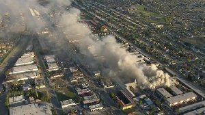 Smoke rises from an apartment building fire in Pico Rivera on Feb. 22, 2018. (Credit: KTLA)