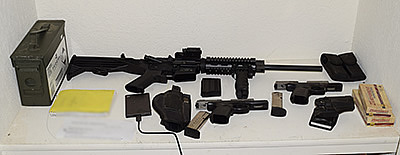 Guns and ammunition allegedly found in Jacob McBain's home are shown in a photo released by the Riverside County Sheriff's Department on Feb. 20, 2018.