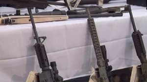 Part of a weapons cache seized at Steven Ponder's Temple City home is shown at a downtown L.A. news conference on Feb. 21, 2018. (Credit: KTLA)