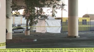 An investigation was underway after human remains were set ablaze in a Home Depot parking lot in Cypress Park on Feb. 1, 2018. (Credit: KTLA)
