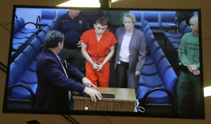 Nikolas Cruz, 19, a former student at Marjory Stoneman Douglas High School in Parkland, Florida, where he allegedly killed 17 people, is seen on a closed circuit television screen during a bond hearing in front of Broward Judge Kim Mollica at the Broward County Courthouse on Feb. 15, 2018, in Fort Lauderdale, Florida. (Credit: Susan Stocker - Pool/Getty Images)
