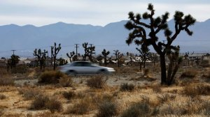A motorist drives along 50th Street, north of Palmdale Boulevard in Palmdale, where Caltrans is preparing to build an eight-lane freeway in the undeveloped Mojave Desert. (Credit: Mel Melcon / Los Angeles Times)