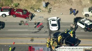 Authorities and onlookers respond to the scene of a multivehicle crash in the 20100 block of Pacific Coast Highway on Feb. 7, 2018. (Credit: KTLA)