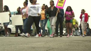 Protestors march in an area of South Los Angeles near where 16-year-old Anthony Weber was shot dead by an L.A. County sheriff's deputy nearly a week earlier, demanding answers in the teen's death. (Credit: KTLA)