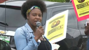 A woman speaks on Feb. 10, 2018, during protests in South Los Angeles in the name of Anthony Weber, a teen who was shot dead by an L.A. County sheriff's deputy about a week earlier. (Credit: KTLA)