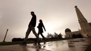 Two people walk outside the Griffith Observatory after a rainstorm in November 2017. (Credit: Al Seib / Los Angeles Times)