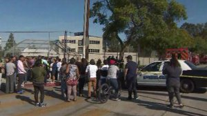 Anxious relatives wait outside Sal Castro Middle School after a shooting on Feb. 1, 2018. (Credit: KTLA)
