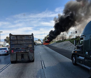 Smoke rises from the scene of a fatal crash on the 10 Freeway on Feb. 16, 2018. (Credit: Vadim Mikhaylov)