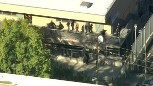 Students appear to be taken out of a classroom at Sal Castro Middle School after a shooting on Feb. 1, 2018. (Credit: KTLA)