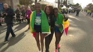 Ethiopians Tsehay Desalegn, left, and Sule Gedo celebrate after placing second and first, respectively, in the women's division at the L.A. Marathon on March 18, 2018. (Credit: KTLA)