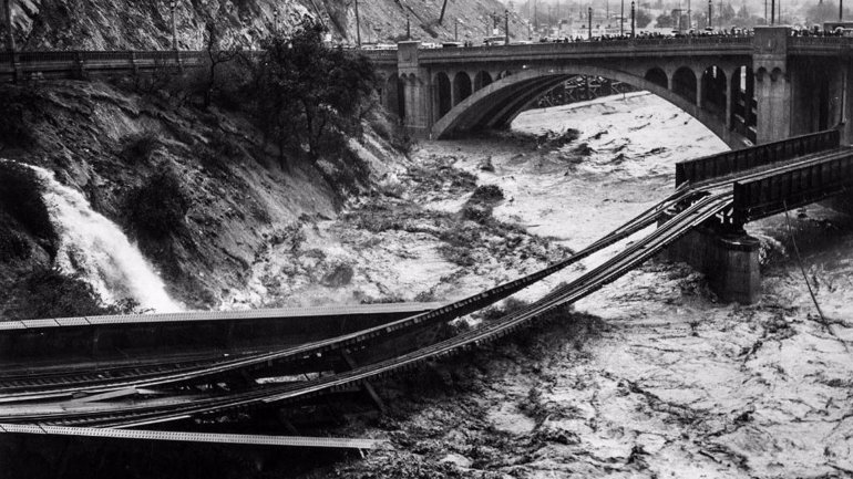 Several weeks of monumental storms would be all it would take to overwhelm California's flood control system and cause widespread flooding and destruction. In this file photo from the Los Angeles Times, floodwaters in the L.A. River on March 2, 1938, destroyed the Southern Pacific railroad bridge.