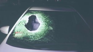 The boulder went through the passenger-side windshield, killing the father-to-be who was sitting in the front seat. (Credit: KTLA)