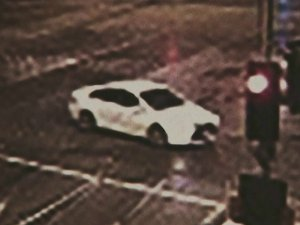 A grainy photo released by police shows the Toyota Camry wanted in connection with the fatal hit-and-run.